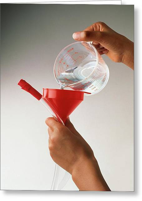 Hand Pouring Water From Jug Into Funnel Greeting Card by Dorling Kindersley/uig