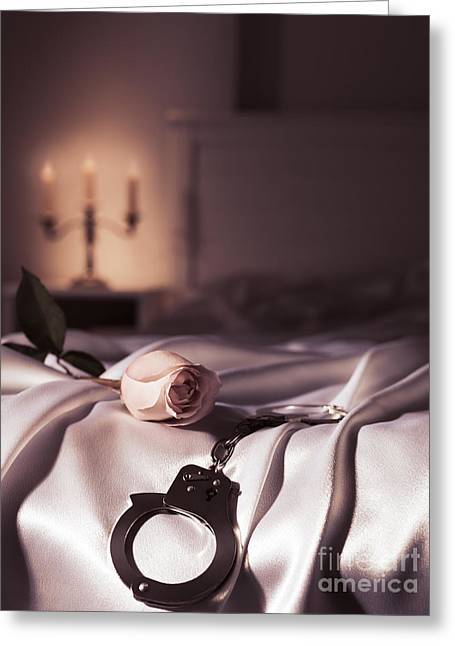 Handcuffs And A Rose On Bed Greeting Card by Oleksiy Maksymenko