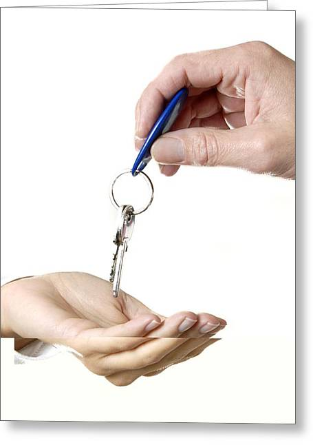 Handing Over Keys Greeting Card by Science Photo Library