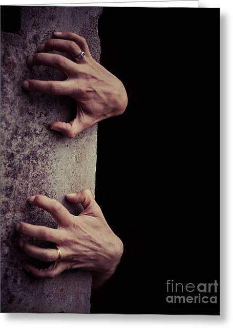 Hands Crawling Out Of The Darkness Greeting Card by Edward Fielding