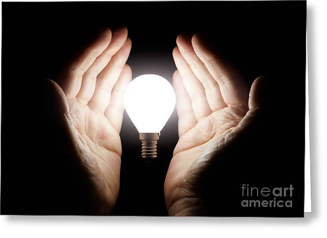 Hands Holding Light Bulb Greeting Card by Simon Bratt Photography LRPS