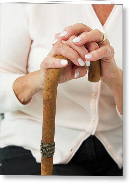 Hands On A Walking Stick Greeting Card