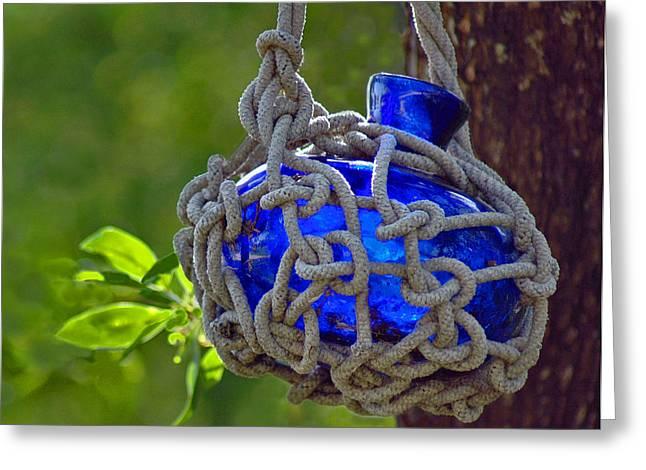 Hanging Blue Bottle Garden Art Greeting Card by Ginger Wakem