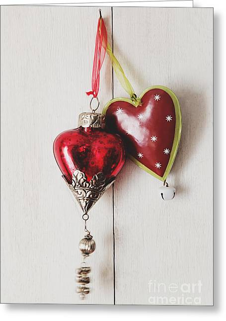 Greeting Card featuring the photograph Hanging Ornaments On White Background by Sandra Cunningham