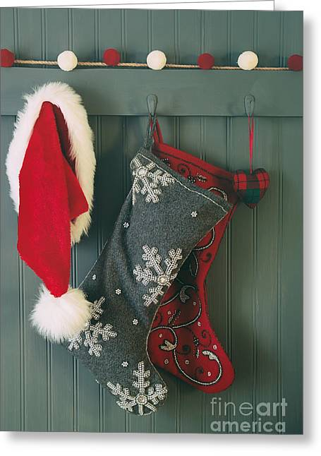 Hanging Stockings And Santa Hat On Hook Greeting Card by Sandra Cunningham