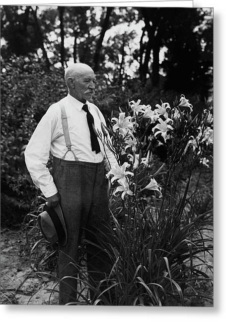 Hans Peter Sass Standing Beside A Flowering Plant Greeting Card by Fleeta Brownell Woodroffe