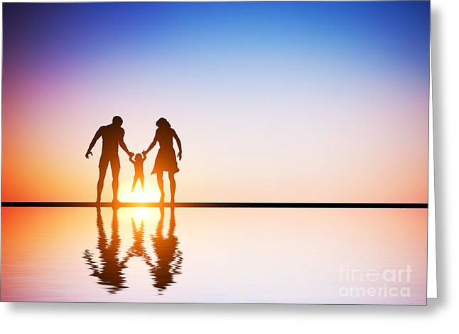 Happy Family Together Parents And Their Child At Sunset Greeting Card