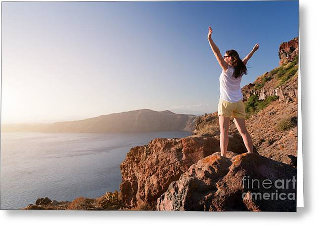 Happy Woman On The Rock With Hands Up Greeting Card