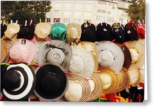 Hats On Display For Sale On The Street Greeting Card by Panoramic Images