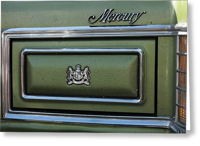 Headlight Cover And The Logo Of The 1975 Green Mercury Marquis Greeting Card by Andrei Filippov