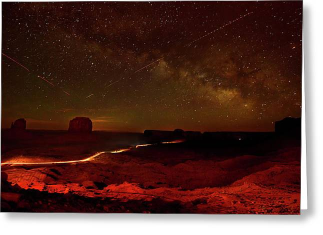 Headlights And Buttes In Monument Greeting Card by Raul Touzon