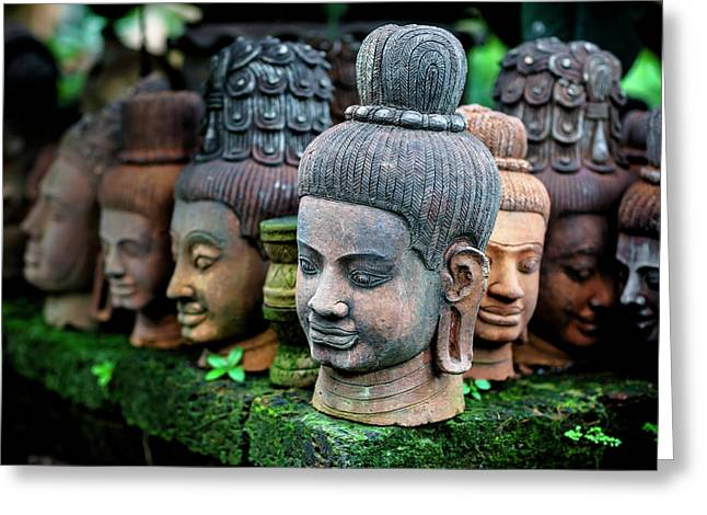 Heads Of Statues Of Buddha Are Stacked Greeting Card by Matt Brandon