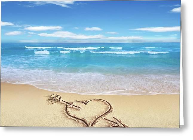Heart Shape On Sandy Beach Greeting Card by Leonello Calvetti