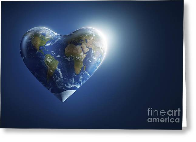 Heart-shaped Planet Earth On A Dark Greeting Card