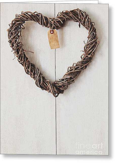 Heart Wreath Hanging On Wood Background Greeting Card by Sandra Cunningham