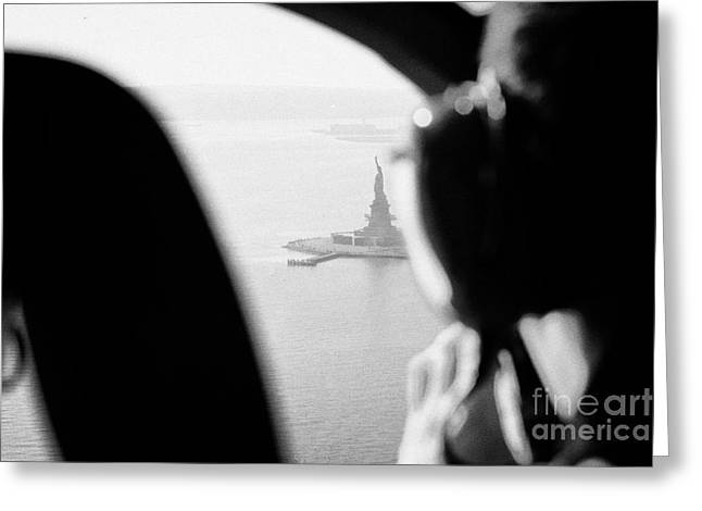 Helicopter  Flies Over Statue Of Liberty As Seen Through The Plexiglas New York Greeting Card