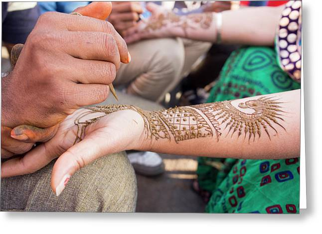 Henna Being Applied On Woman's Hand Greeting Card