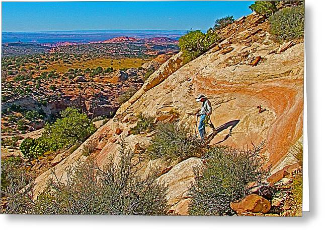 Hiking Down Steep Slickrock Of Aztec Butte Trail In Island In The Sky In Canyonlands Np-utah Greeting Card by Ruth Hager