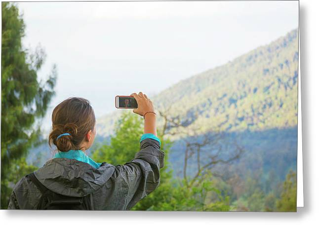 Hiking Woman Taking Photo With Smart Greeting Card