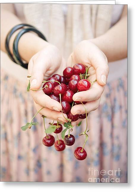 Holding Cherries  Greeting Card by Viktor Pravdica