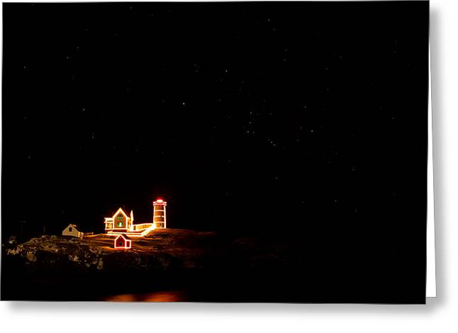 Holiday Lights At Nubble Light Greeting Card by Jeff Sinon