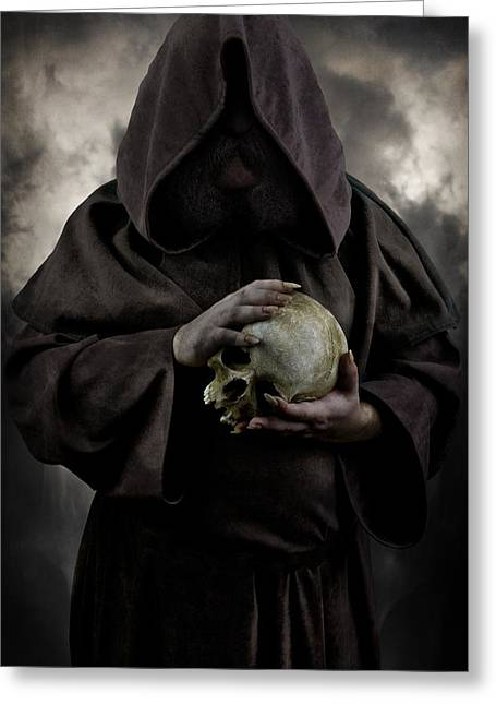Hooded Moustached Man Wearing Dark Cloak And Holding A Human Skull In His Hands Greeting Card