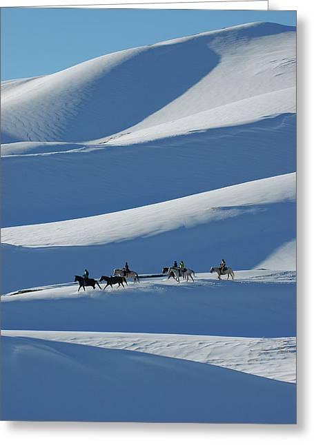 Horseback Riders On Winter Dunes Greeting Card