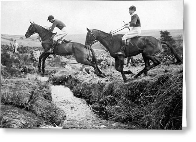 Horses Jumping A Creek Greeting Card by Underwood Archives