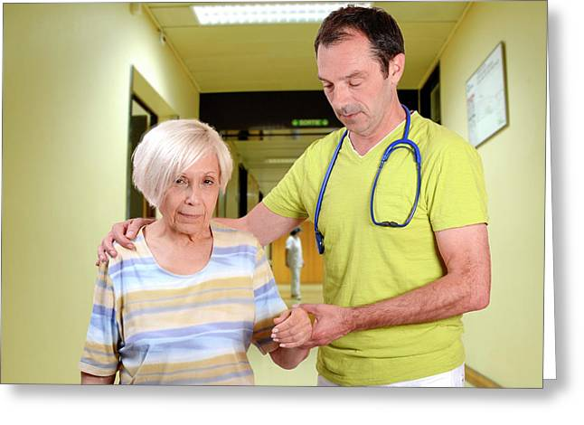 Hospital Doctor Assisting Elderly Woman Greeting Card