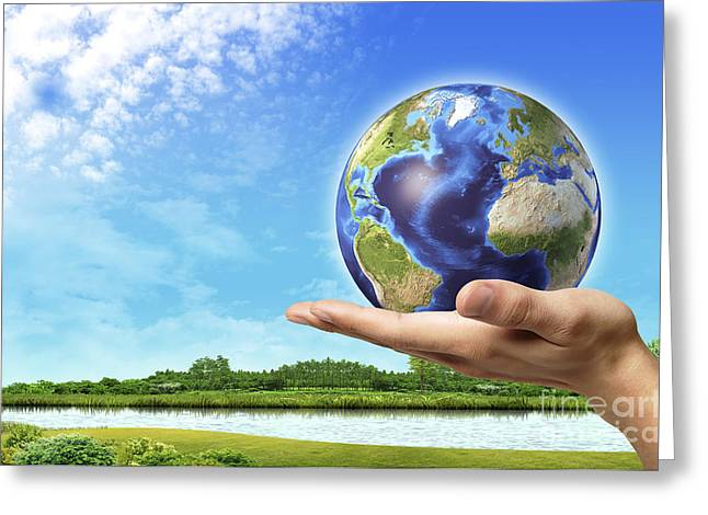 Human Hand Holding Earth Globe Greeting Card by Leonello Calvetti
