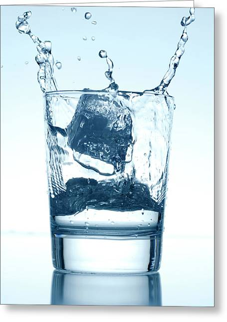 Ice Cube Falling Into A Glass Of Water Greeting Card by Panoramic Images