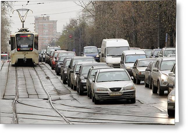 Illegally Parked Cars Next To Tramline Greeting Card by Science Photo Library