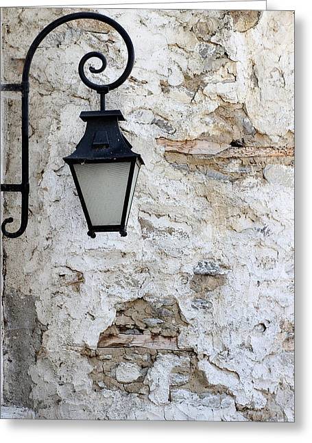 Iron Lantern On A Old Brick Wall Greeting Card by Kamen Zagorov