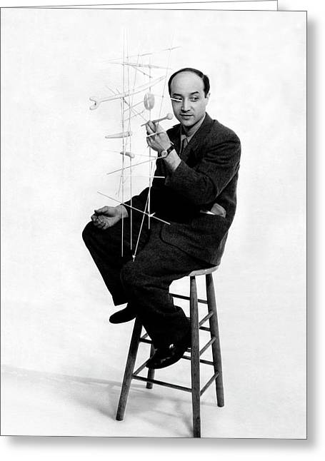 Isamu Noguchi Holding One Of His Structures Greeting Card by Herbert Matter