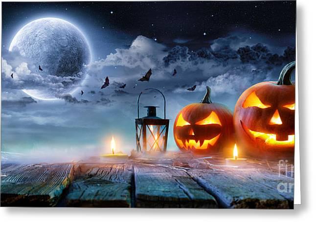 Jack O' Lanterns Glowing At Moonlight Greeting Card