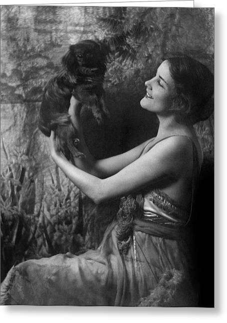 Jeanne Eagels Lifting Up A Small Dog Greeting Card by Arnold Genthe