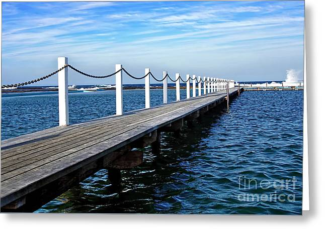 Jetty Stretching To The Ocean Greeting Card by Kaye Menner