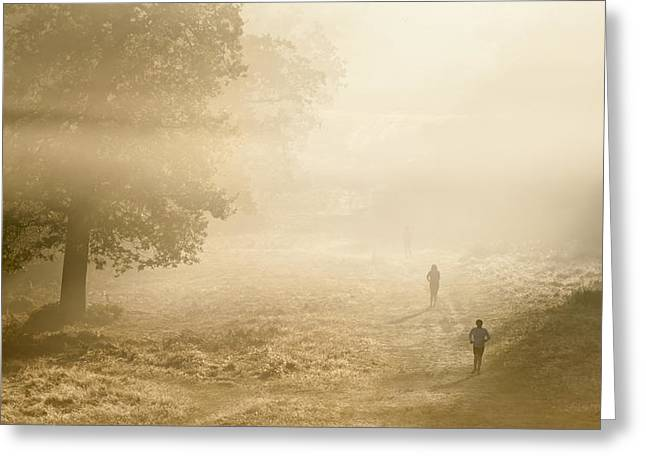 Joggers In Richmond Park London On A Crisp Foggy Autumn Morning Greeting Card by Matthew Gibson