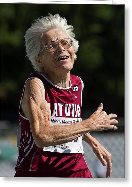 Joyful Senior Female Athlete Greeting Card