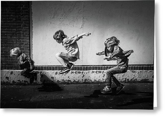 Jumping Over The Shadows Greeting Card