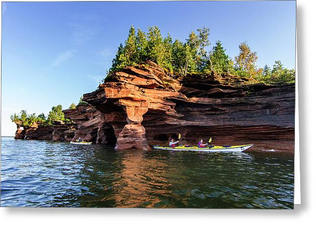 Kayakers Exploring The Sea Caves Greeting Card by Chuck Haney