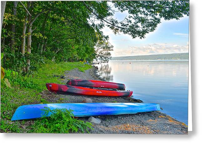 Kayaks Await Greeting Card by Frozen in Time Fine Art Photography