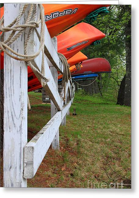 Kayaks On A Fence Greeting Card