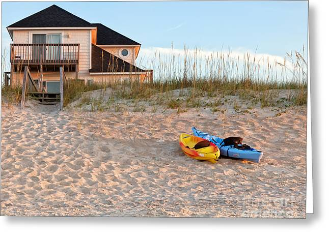 Kayaks Rest On Sand Dune In Morning Sun. Greeting Card