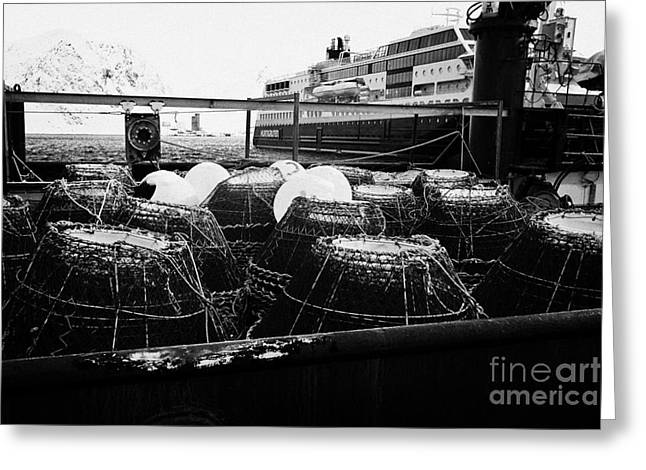 king crab pots on the rear deck of a fishing boat Honningsvag harbour finnmark norway europe Greeting Card by Joe Fox