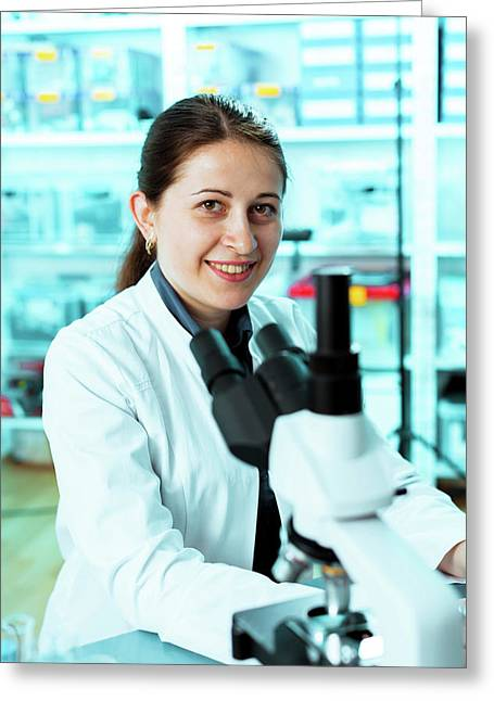 Lab Technician With A Microscope Greeting Card by Wladimir Bulgar/science Photo Library