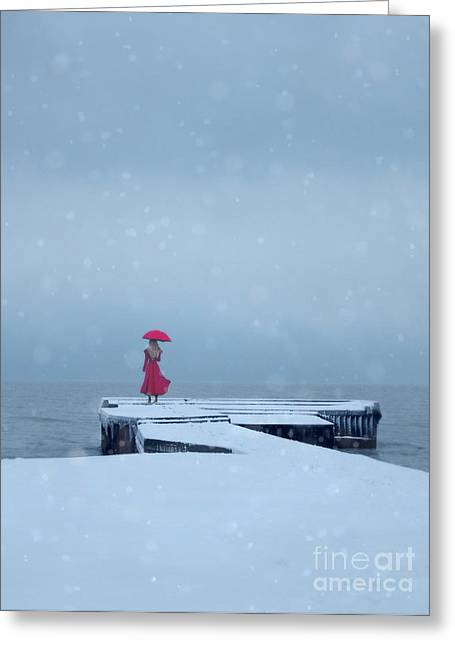 Lady In Red On Snowy Pier Greeting Card