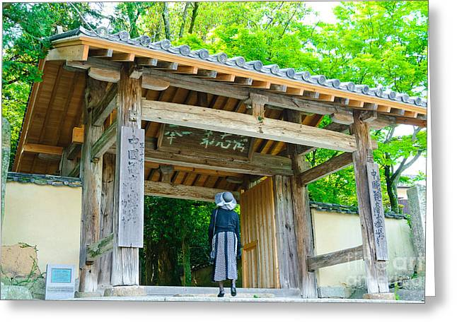 Lady Looking Up At The Impressive Woodwork Of A Japanese Temple Gate Greeting Card