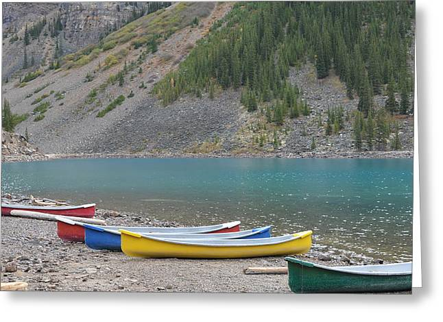 Lake Moraine Canoes Greeting Card by Cheryl Miller