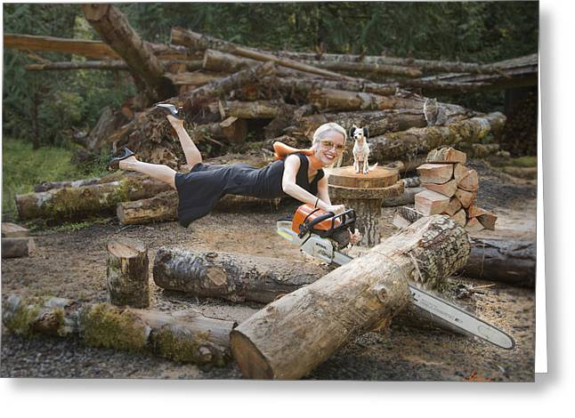 Levitating Housewife - Cutting Firewood Greeting Card by Lori Grimmett